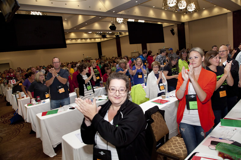 Delegates applauding